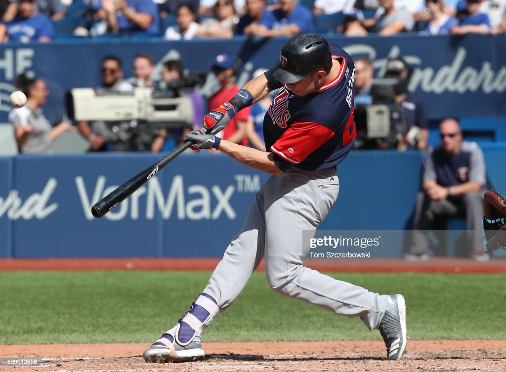 Max Kepler #26 of the Minnesota Twins hits a grand slam home run in the eighth inning during MLB game action against the Toronto Blue Jays at Rogers Centre on August 26, 2017 in Toronto, Canada.