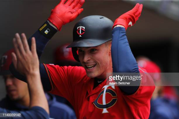Max Kepler of the Minnesota Twins is all smiles in the dugout after hitting a home run in the first at bat in the first inning against the Baltimore...