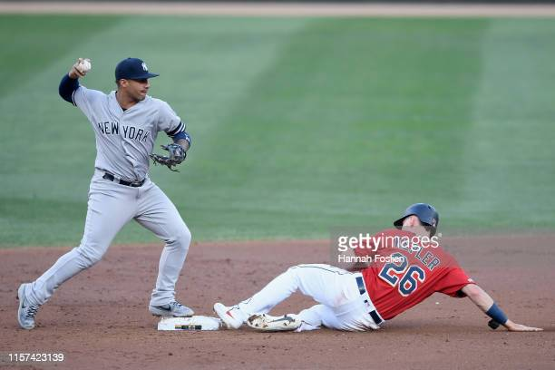 Max Kepler of the Minnesota Twins is out at second base as Gleyber Torres of the New York Yankees turns a double play during the first inning of the...