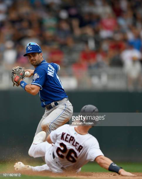 Max Kepler of the Minnesota Twins is out at second base as Whit Merrifield of the Kansas City Royals turns a double play during the sixth inning of...