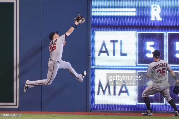 Max Kepler of the Minnesota Twins makes a catch as he runs into the wall in the third inning during MLB game action against the Toronto Blue Jays at...