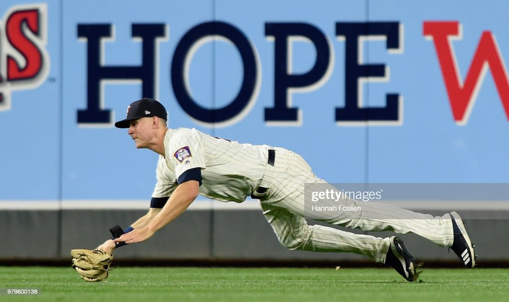 Max Kepler #26 of the Minnesota Twins makes a catch in right field of the ball hit by J.D. Martinez #28 of the Boston Red Sox during the eighth inning of the game on June 20, 2018 at Target Field in Minneapolis, Minnesota. The Twins defeated the Red Sox 4-1.