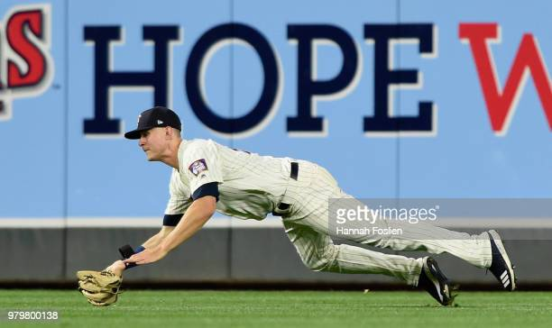 Max Kepler of the Minnesota Twins makes a catch in right field of the ball hit by JD Martinez of the Boston Red Sox during the eighth inning of the...