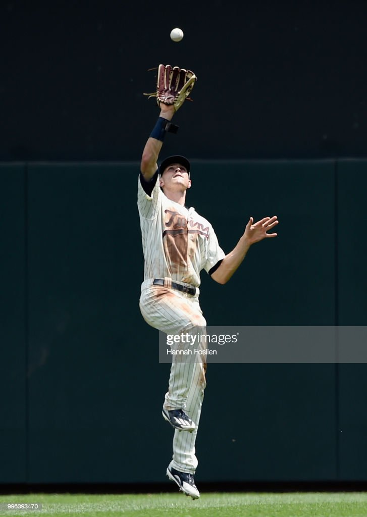 Max Kepler #26 of the Minnesota Twins makes a catch in right field of the ball hit by Mike Moustakas #8 of the Kansas City Royals during the fifth inning of the game on July 11, 2018 at Target Field in Minneapolis, Minnesota.