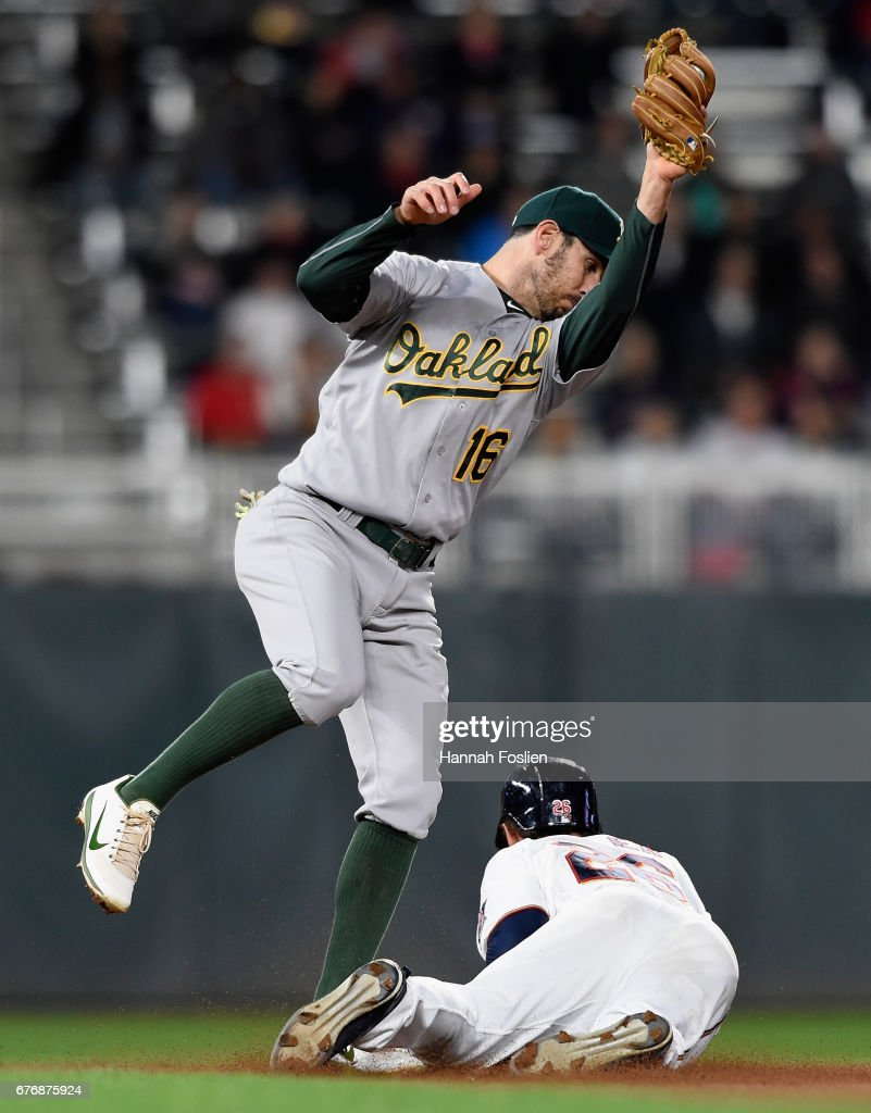 Max Kepler #26 of the Minnesota Twins steals second base against Adam Rosales #16 of the Oakland Athletics during the fifth inning of the game on May 2, 2017 at Target Field in Minneapolis, Minnesota. The Twins defeated the Athletics 9-1.