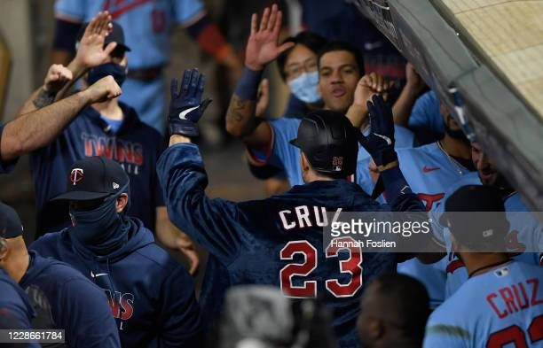 Max Kepler of the Minnesota Twins wears a bathrobe belonging to teammate Nelson Cruz as he celebrates a solo home run against the Detroit Tigers in...