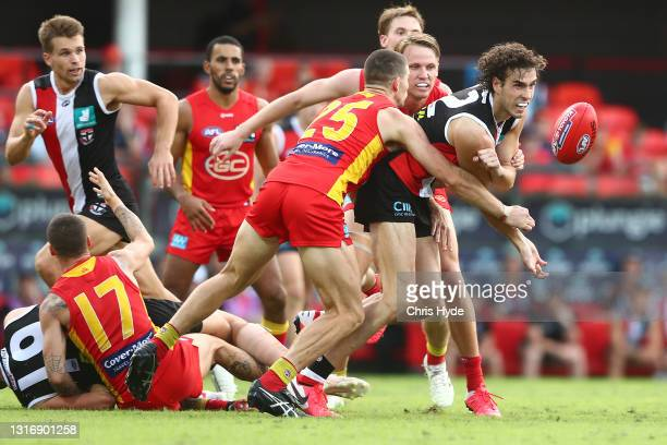 Max King of the Saints handballs during the round eight AFL match between the Gold Coast Suns and the St Kilda Saints at Metricon Stadium on May 08,...
