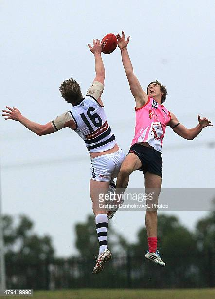 Max King of the Scorpions and Dawson Simpson of the Cats contest the ball in the air during the round 12 VFL match between the Casey Scorpions and...