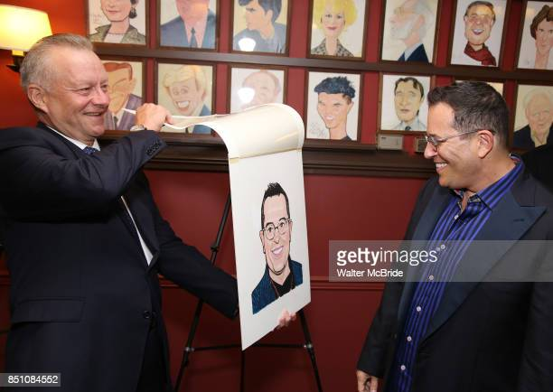 Max Klimavicius and Michael Mayer during the Michael Moore And Michael Mayer portrait unveilings as they join the Wall of Fame at Sardi's on...