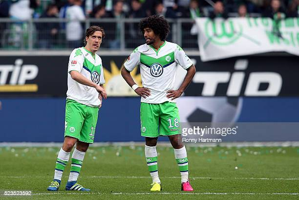 Max Kruse and Dante of Wolfsburg react after the Bundesliga match between VfL Wolfsburg and FC Augsburg at Volkswagen Arena on April 23 2016 in...
