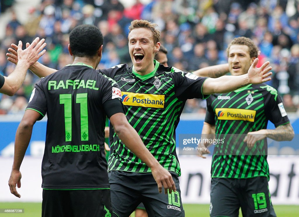 Max Kruse congratulates Raffael of Borussia Moenchengladbach after he scored the third goal during the Bundesliga match between 1899 Hoffenheim and Borussia Moenchengladbach at Wirsol Rhein-Neckar-Arena on April 4, 2015 in Sinsheim, Germany.