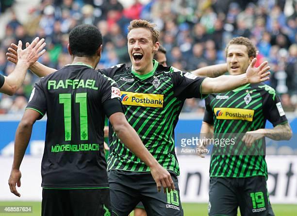 Max Kruse congratulates Raffael of Borussia Moenchengladbach after he scored the third goal during the Bundesliga match between 1899 Hoffenheim and...