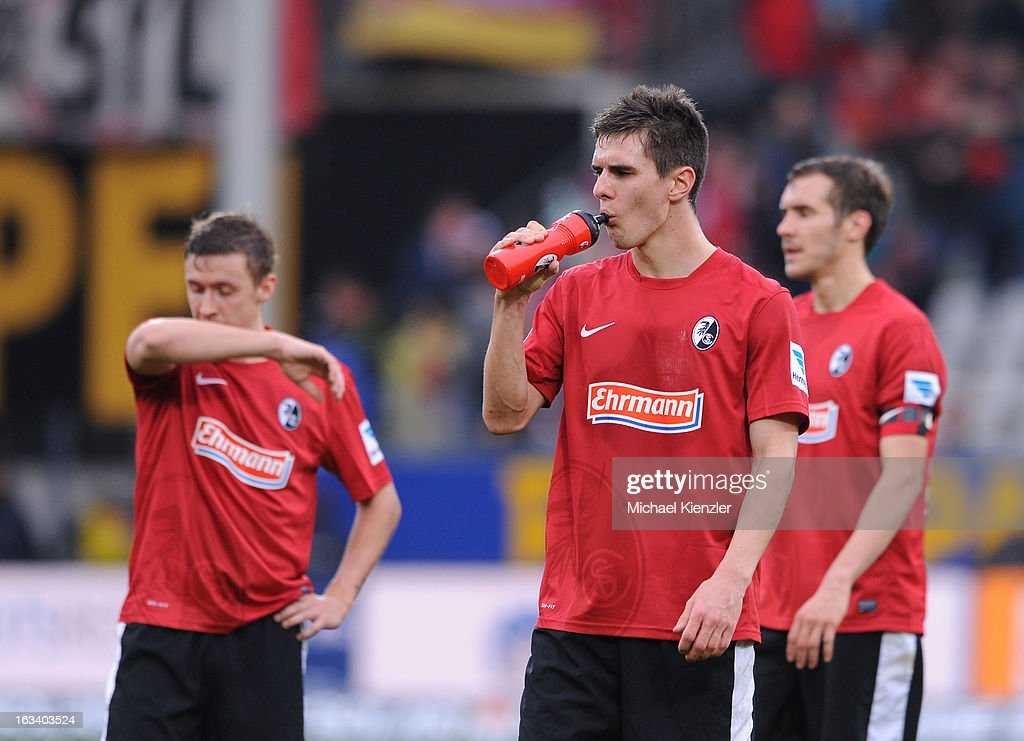 Max Kruse, Johannes Flum and Julian Schuster of Freiburg standing disappointed on field after the Bundesliga match between SC Freiburg and VfL Wolfsburg at MAGE SOLAR Stadium on March 9, 2013 in Freiburg, Germany.