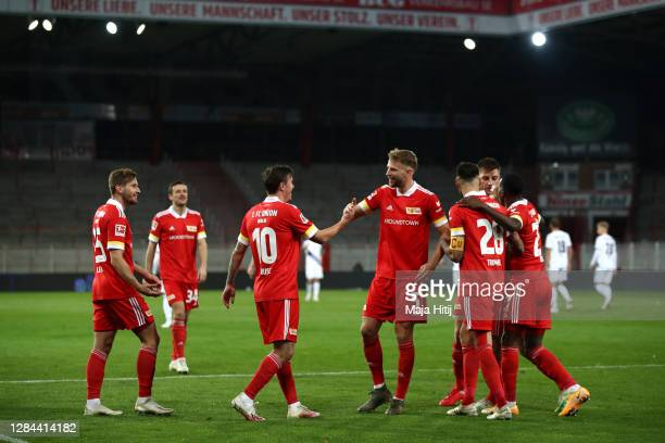 Max Kruse of 1. FC Union Berlin celebrates with teammates after scoring his team's fourth goal during the Bundesliga match between 1. FC Union Berlin...
