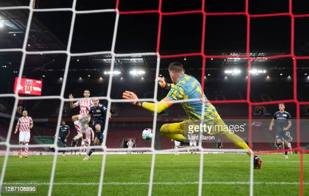 Max Kruse of Berlin scores his teams second goal against goalkeeper Timo Horn of Cologne during the Bundesliga match between 1 FC Koeln and 1 FC...