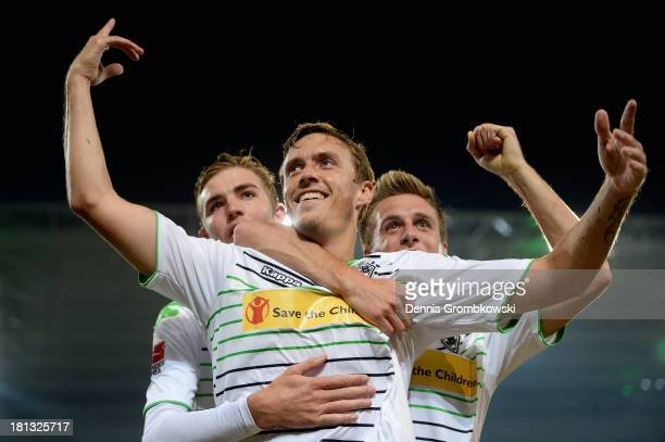 Max Kruse of Borussia Moenchengladbach celebrates after scoring his team's third goal during the Bundesliga match between Borussia Moenchengladbach...