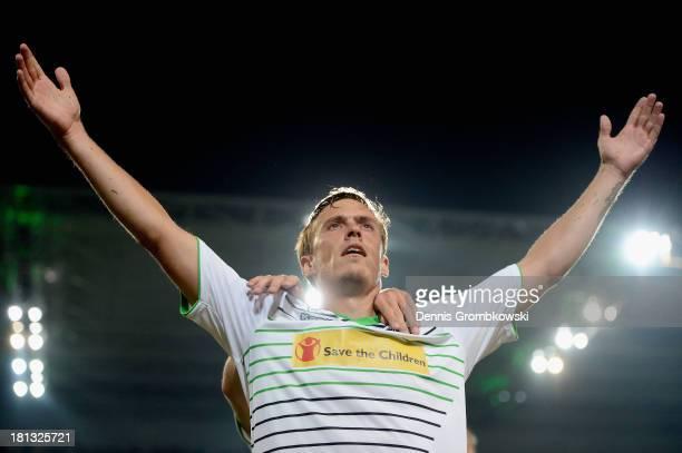 Max Kruse of Borussia Moenchengladbach celebrates after scoring his team's third goal during the Bundesliga match between Borussia Moenchengladbach...
