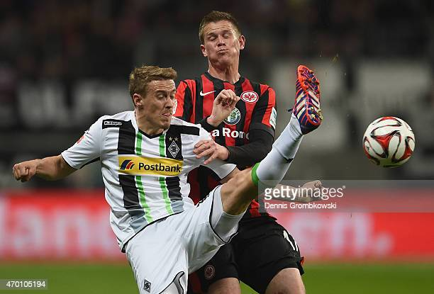 Max Kruse of Borussia Moenchengladbach is challenged by Alexander Madlung of Eintracht Frankfurt during the Bundesliga match between Eintracht...