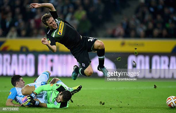 Max Kruse of Borussia Moenchengladbach is challenged by Angelis Angelis and Bruno Vale of Apollon Limassol FC during the UEFA Europa League group...