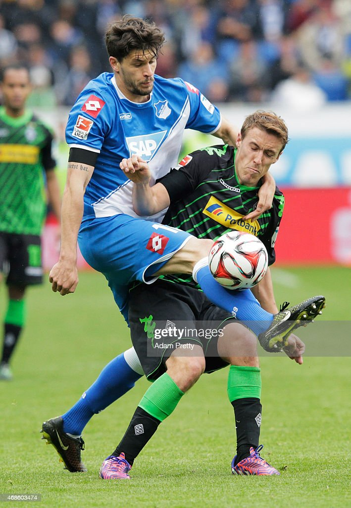 Max Kruse of Borussia Moenchengladbach is tackled strongly by Tobias Strobl of 1899 Hoffenheim during the Bundesliga match between 1899 Hoffenheim and Borussia Moenchengladbach at Wirsol Rhein-Neckar-Arena on April 4, 2015 in Sinsheim, Germany.