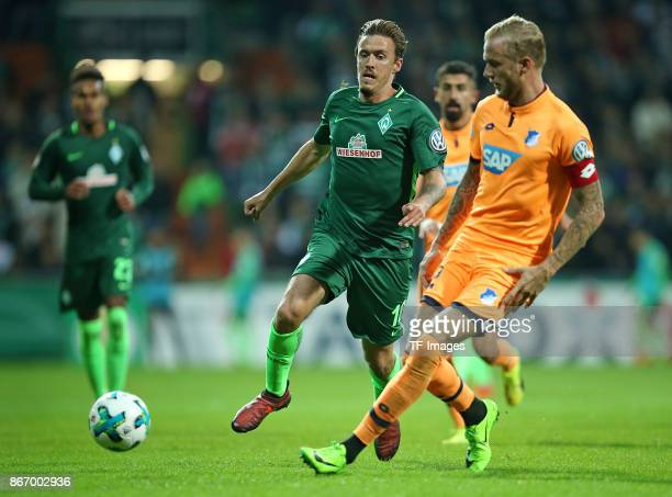 Max Kruse of Bremen and Kevin Vogt of Hoffenheim battle for the ball during the DFB Cup match between Werder Bremen and 1899 Hoffenheim at...