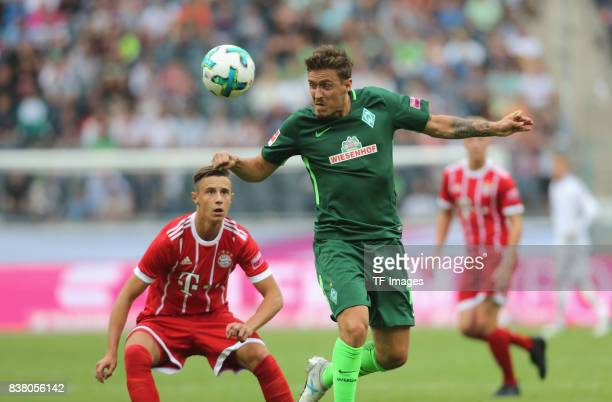 Max Kruse of Bremen and Marco Friedl of Muenchen battle for the ball during the Telekom Cup 2017 Final between SV Werder Bremen and FC Bayern...