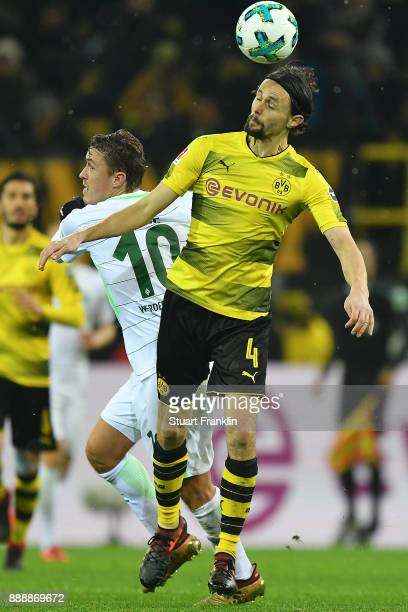 Max Kruse of Bremen and Neven Subotic of Dortmund fights of the ball during the Bundesliga match between Borussia Dortmund and SV Werder Bremen at...