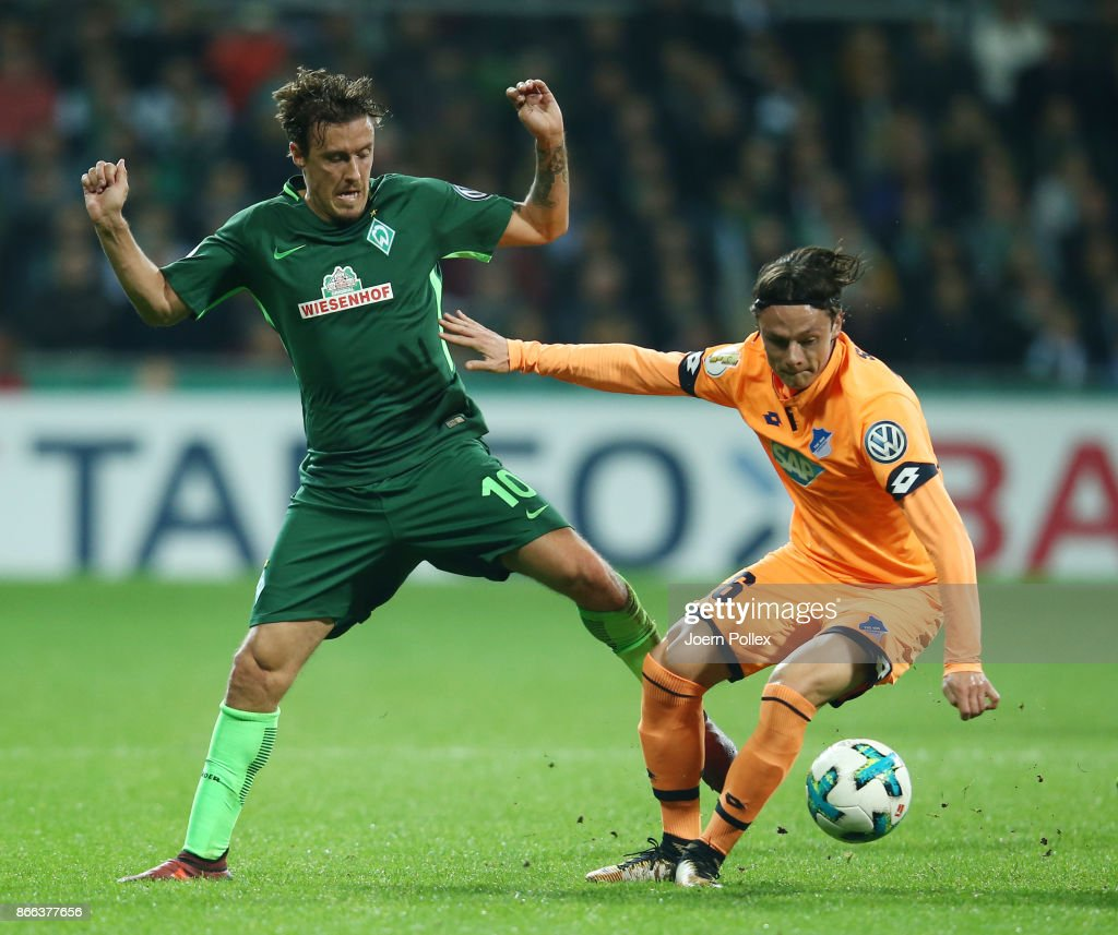 Max Kruse of Bremen and Nico Schulz of Hoffenheim compete for the ball during the DFB Cup match between Werder Bremen and 1899 Hoffenheim at Weserstadion on October 25, 2017 in Bremen, Germany.