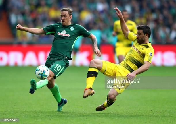 Max Kruse of Bremen and Sokratis of Dortmund battle for the ball during the Bundesliga match between SV Werder Bremen and Borussia Dortmund at...