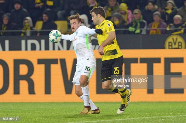 Max Kruse of Bremen and Sokratis Papastathopoulos of Dortmund battle for the ball during the Bundesliga match between Borussia Dortmund and SV Werder...