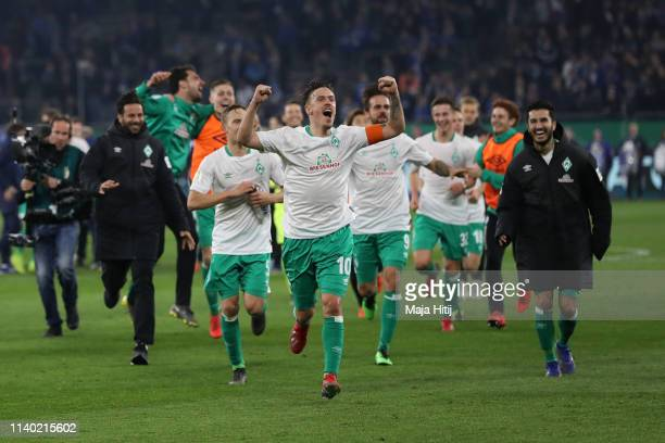 Max Kruse of Bremen and team mates celebrate after the DFB Cup quarterfinal match between FC Schalke 04 and Werder Bremen at VeltinsArena on April 03...