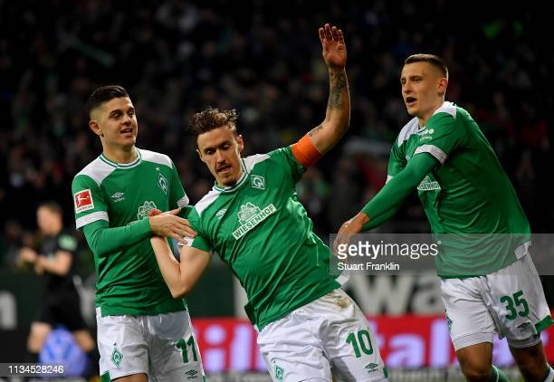 Max Kruse of Bremen celebrate with team mate Milot Rashica and Maximilian Eggestein after he scores the 2nd goal during the Bundesliga match between...