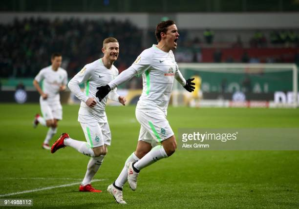 Max Kruse of Bremen celebrates after he scores the opening goal by penalty kick during the DFB Cup quarter final match between Bayer Leverkusen and...