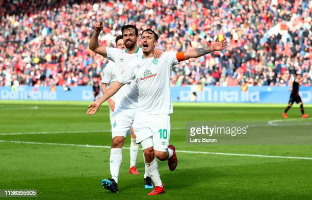 Max Kruse of Bremen celebrates after scoring his teams third goal during the Bundesliga match between Bayer 04 Leverkusen and SV Werder Bremen at...