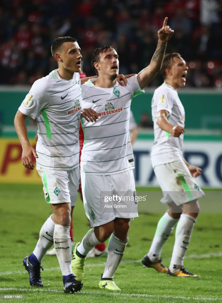 Max Kruse of Bremen celebrates his team's second goal with team mate Maximilian Eggestein during the DFB Cup first round match between Wuerzburger Kickers and SV Werder Bremen at Sparda-Bank-Hessen-Stadion on August 12, 2017 in Offenbach, Germany.