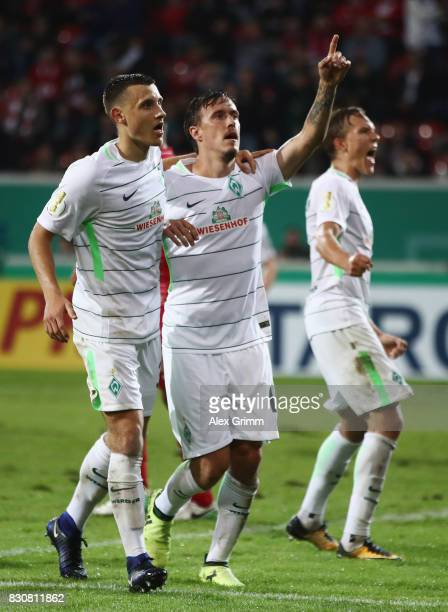 Max Kruse of Bremen celebrates his team's second goal with team mate Maximilian Eggestein during the DFB Cup first round match between Wuerzburger...