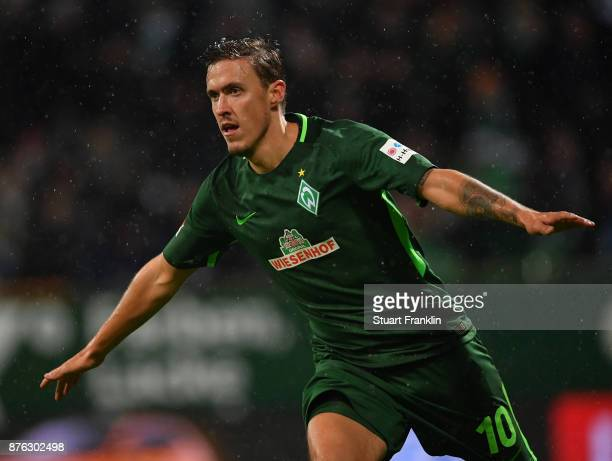 Max Kruse of Bremen celebrates scoring his first goal during the Bundesliga match between SV Werder Bremen and Hannover 96 at Weserstadion on...