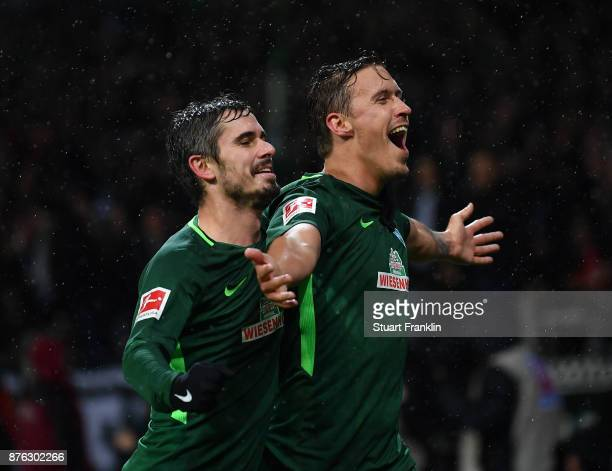 Max Kruse of Bremen celebrates scoring his second goal with Fin Bartles during the Bundesliga match between SV Werder Bremen and Hannover 96 at...