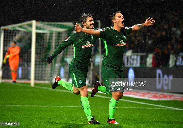 Max Kruse of Bremen celebrates scoring his second goal with Fin Bartels during the Bundesliga match between SV Werder Bremen and Hannover 96 at...
