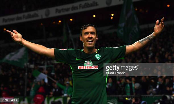 Max Kruse of Bremen celebrates scoring his third goal during the Bundesliga match between SV Werder Bremen and Hannover 96 at Weserstadion on...