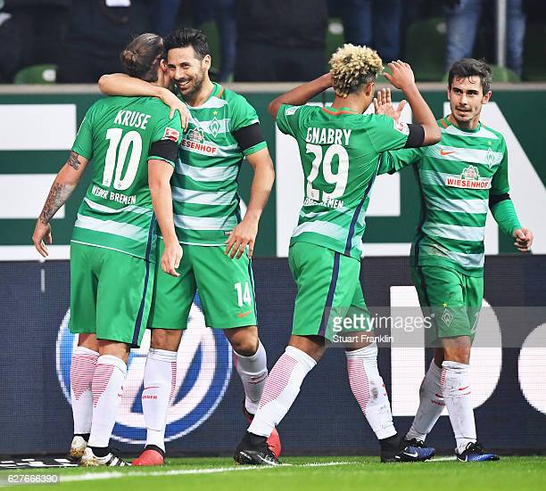 Max Kruse of Bremen celebrates scoring the first goal with Claudio Pizarro during the Bundesliga match between Werder Bremen and FC Ingolstadt 04 at...