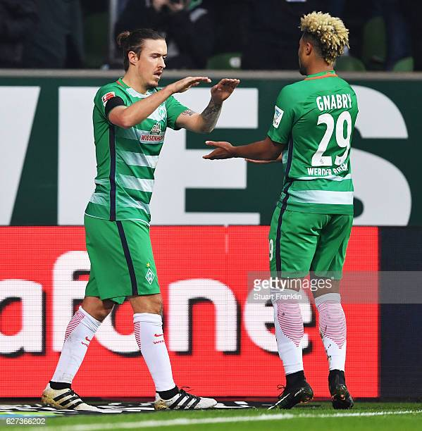 Max Kruse of Bremen celebrates scoring the first goal with Serge Gnabry during the Bundesliga match between Werder Bremen and FC Ingolstadt 04 at...