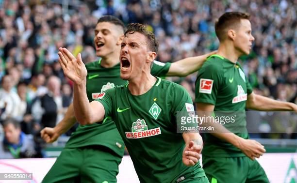 Max Kruse of Bremen celebrates the opening goal during the Bundesliga match between SV Werder Bremen and RB Leipzig at Weserstadion on April 15 2018...