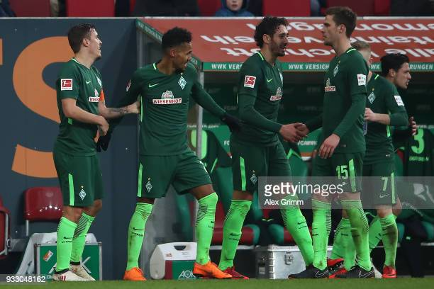 Max Kruse of Bremen celebrates with his team after he scored a goal to make it 13 during the Bundesliga match between FC Augsburg and SV Werder...