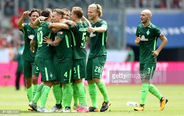Max Kruse of Bremen celebrates with team mates after winning the Telekom Cup 2017 match between Borussia Moenchengladbach and Werder Bremen at on...