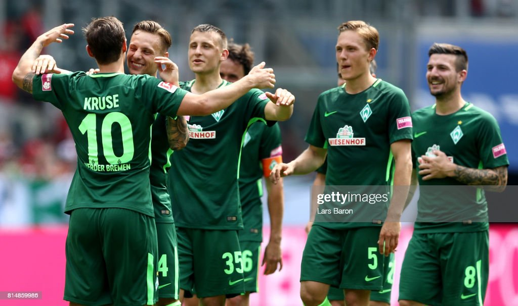 Max Kruse of Bremen celebrates with team mates after winning the Telekom Cup 2017 match between Borussia Moenchengladbach and Werder Bremen at on July 15, 2017 in Moenchengladbach, Germany.