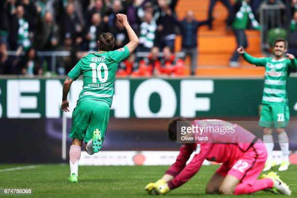 Max Kruse of Bremen celebrates with teammates after his team's first goalduring the Bundesliga match between Werder Bremen and Hertha BSC at...