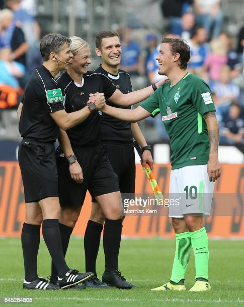 Max Kruse of Bremen congratulates referee Bibiana Steinhaus after the Bundesliga match between Hertha BSC and SV Werder Bremen at Olympiastadion on...