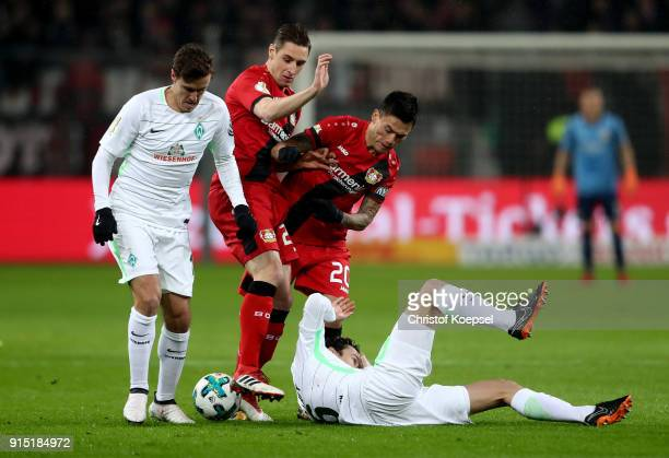 Max Kruse of Bremen Dominik Kohr and Charles Aranguiz of Leverkusen and Thomas Delaney of Bremen fight for the ball during the DFB Cup quarter final...