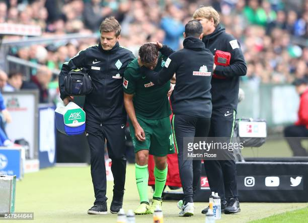 Max Kruse of Bremen has to leave the match injured during the Bundesliga match between SV Werder Bremen and FC Schalke 04 at Weserstadion on...